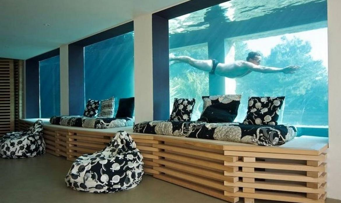 This Airbnb Home Comes With A Giant 91 Foot Aquarium Pool