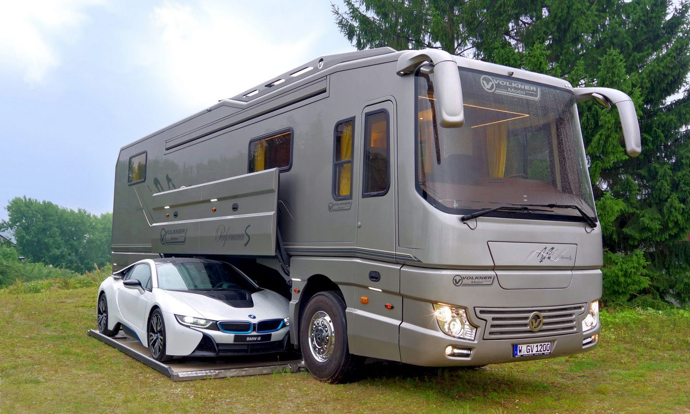 Interiors of a well-appointed penthouse and a garage for your Porsche, this $1.7 million luxury motorhome is badass