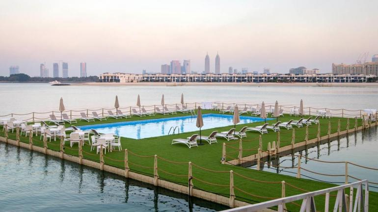 Risultati immagini per Dubai adds a floating swimming pool to its ridiculous roster of innovations FOTO