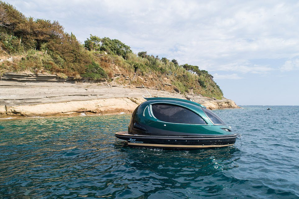 This spaceship-like futuristic luxury watercraft fits 12 people and can hit a top speed of 71mph