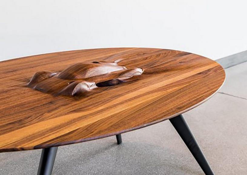This $17,000 tailor-made coffee table has the silhouette of Aston Martin Valkyrie built onto its surface