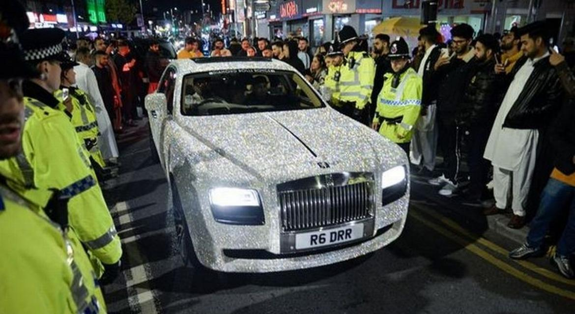 So bright you will need sunglasses - A Rolls Royce covered in four million Swarovski crystal takes over the streets of London -