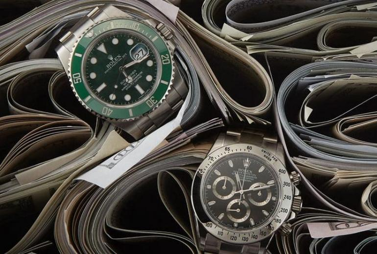 Quora answers - How to spot a fake Rolex? -