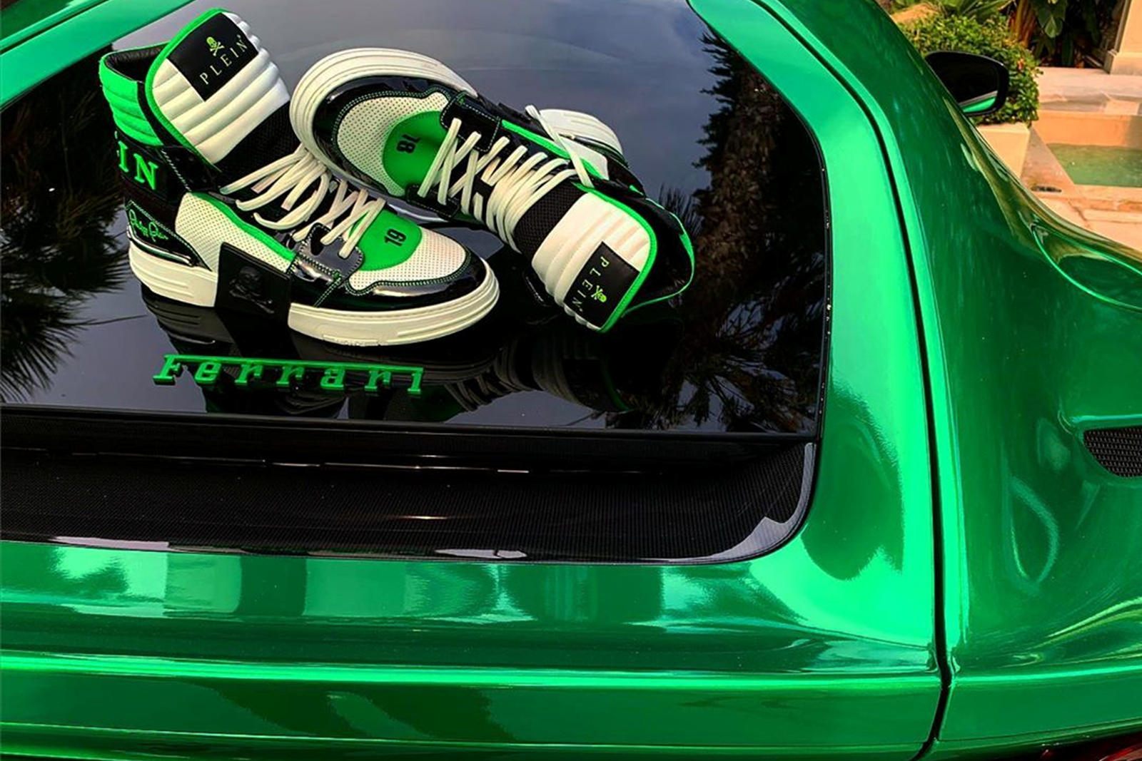Fashion designer may get sued by Ferrari for posting pics of his shoes On top of his own Ferrari