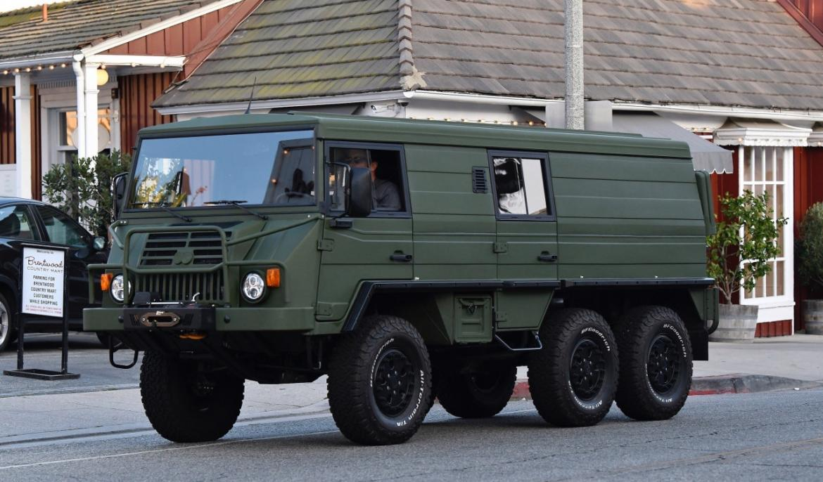 Arnold Schwarzenegger spotted driving a tank-like military vehicle to run errands -