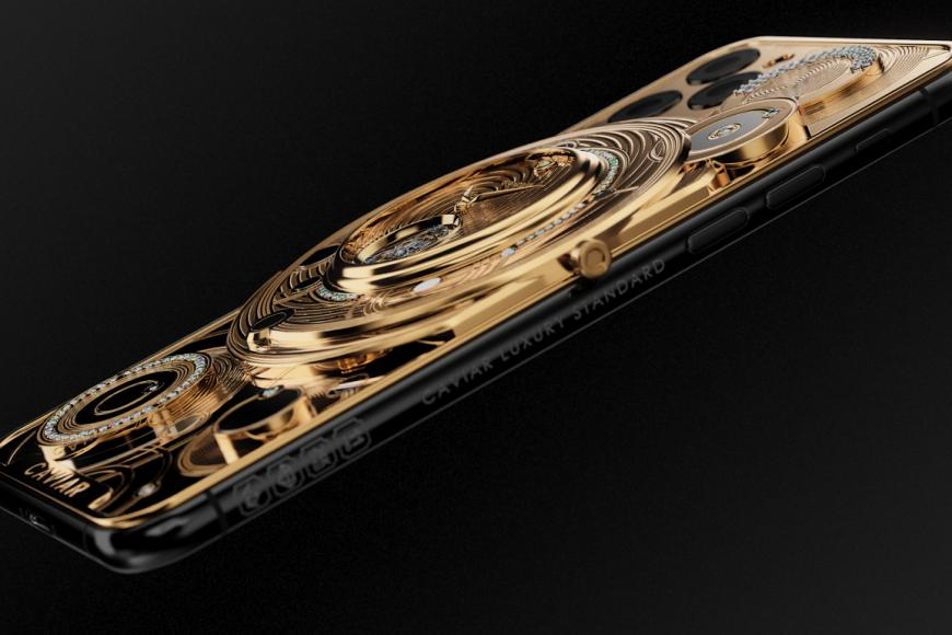 Image result for This gold-encrusted one-off iPhone 11 Pro by Caviar costs $70,000 and has a mechanical watch on the back