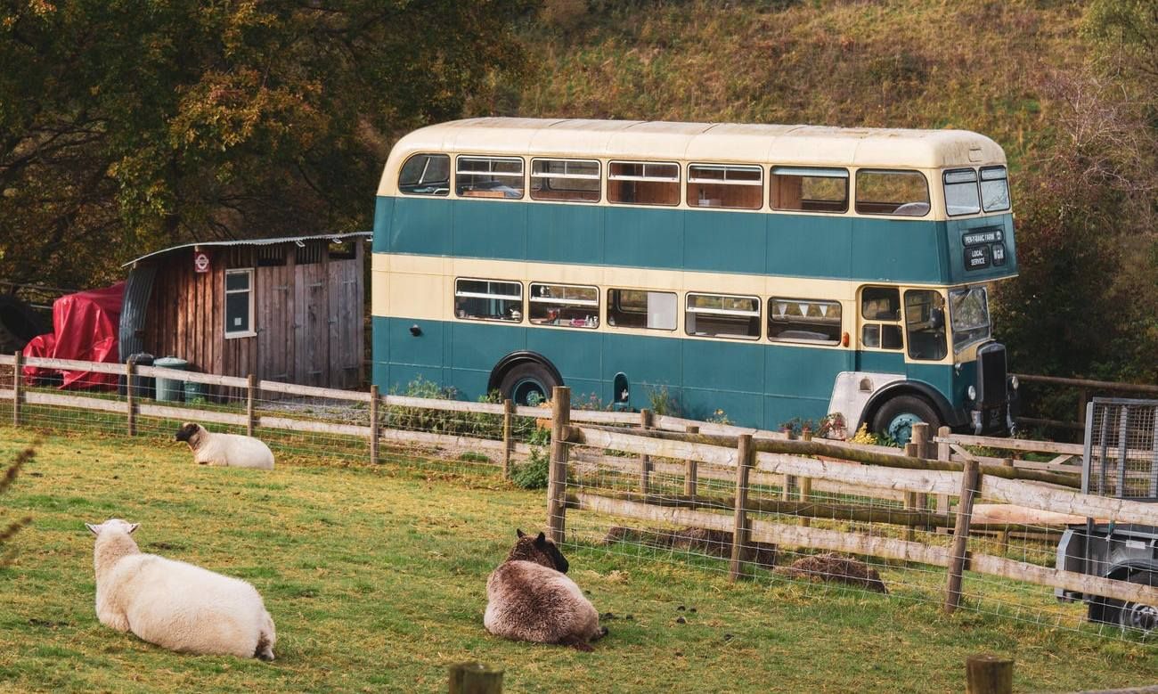 You can now live inside a double-decker bus on a lush farm in Wales
