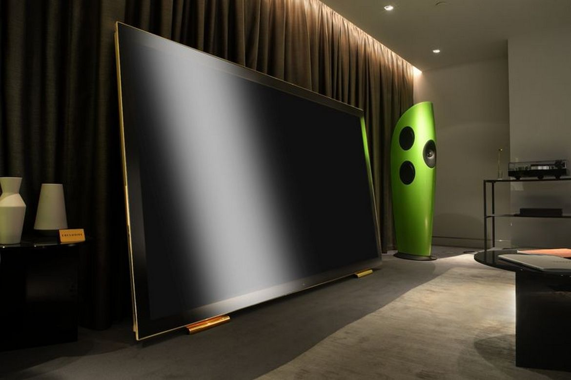 Could this be the most luxurious TV in the world? Its 100 inches wide, has a gold plated stand and costs $130,000