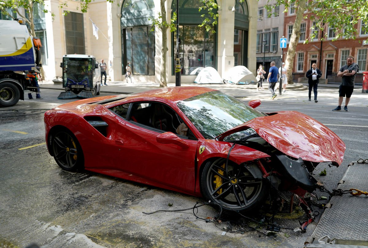 Video - British rapper's $300,000 Ferrari is a squashed wrecked after colliding with a double decker bus in Central London : Luxurylaunches