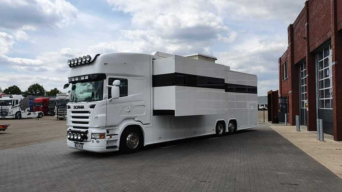 A commodious living room, three posh bedrooms, and a well-equipped garage, this fancy Scania RV has it all