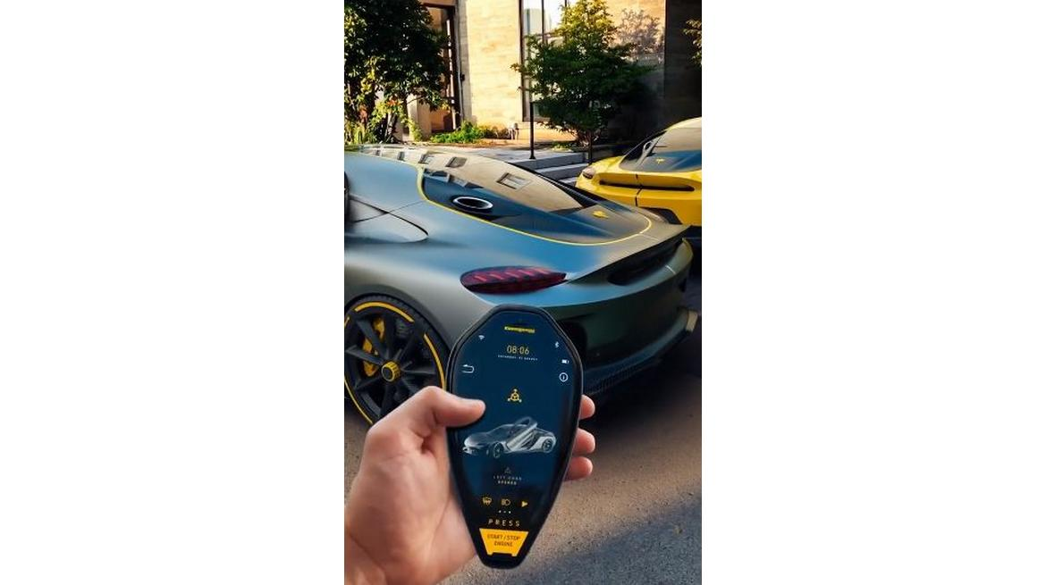 "The $1.9 million Koenigsegg Gemera ""Hybrid"" supercar gets a Key Fob concept that puts a stylish smartphone into a physical key"