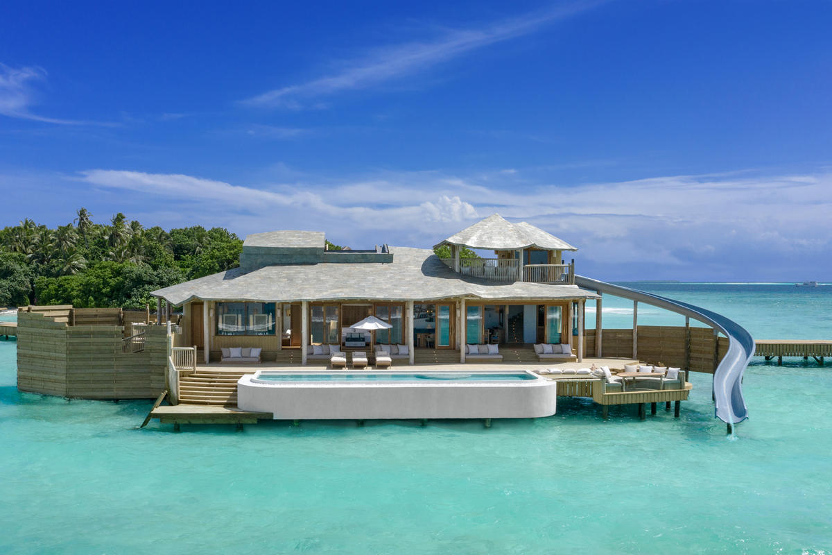 Complete with a water slide, outdoor deck, private pool, and a retractable roof – The new overwater villas at Soneva Fushi are a little piece of heaven on Earth