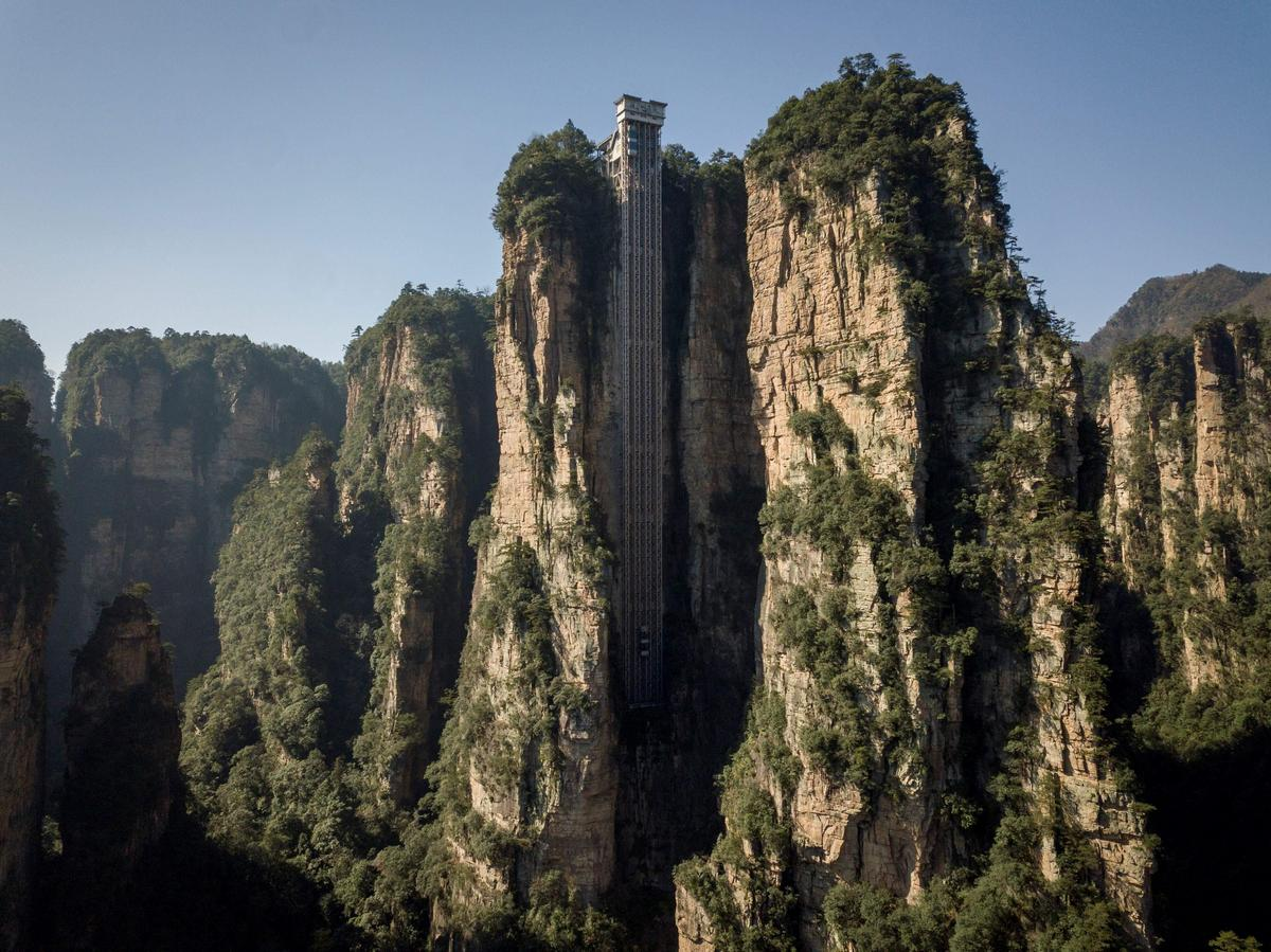 China has built the worlds highest outdoor elevator – The massive glass lift zips tourists to a 1,070 feet cliff that had inspired the landscape of avatar