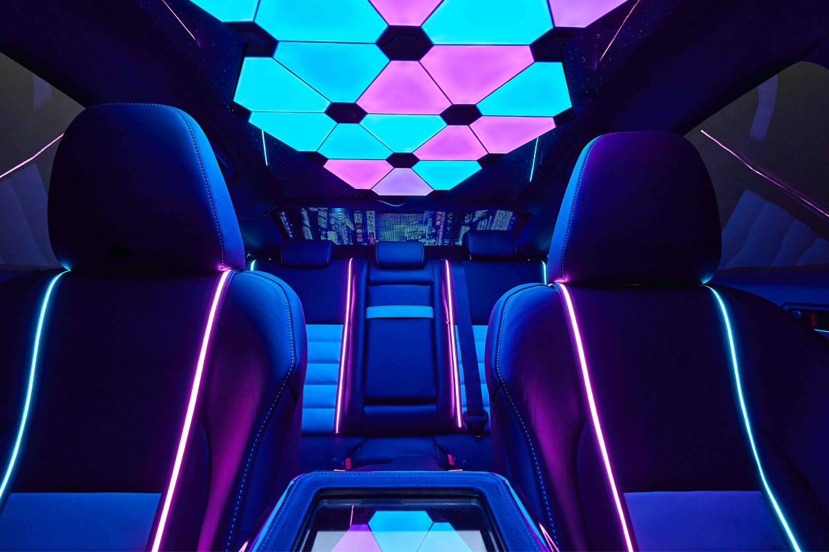 Neon Tokyo interior, custom gaming PC and a vinyl wrap – Lexus has surely created the ultimate gamers car